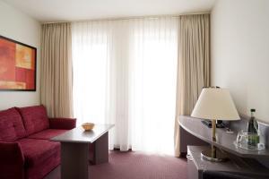 Ein Sitzbereich in der Unterkunft Hotel Erfurter Tor