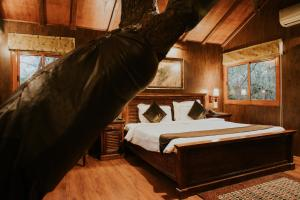 A bed or beds in a room at The Tree House Resort
