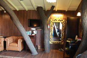 A television and/or entertainment center at The Tree House Resort