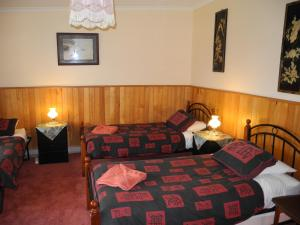 A bed or beds in a room at Happy Days Accommodation