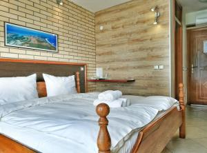 A bed or beds in a room at Royal View Villa