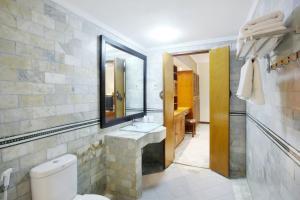 Ванная комната в Bali Bungalo Hotel