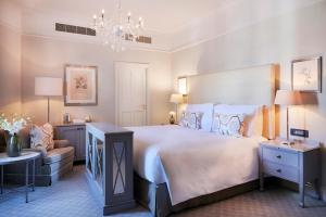A bed or beds in a room at Mount Nelson, A Belmond Hotel, Cape Town