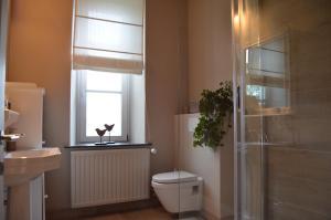 Salle de bains dans l'établissement Les Glaneuses