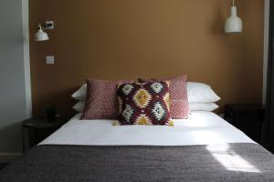 A bed or beds in a room at The Town & Country Lodge
