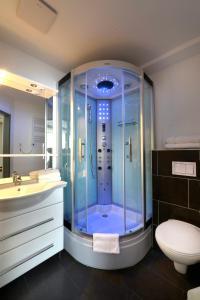 Ein Badezimmer in der Unterkunft Petul Apart Hotel City Premium