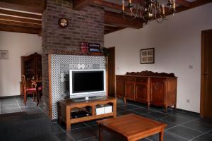 Een TV en/of entertainmentcenter bij Vakantiewoning Het Oude Laer