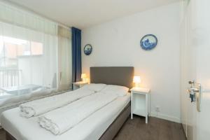 Een bed of bedden in een kamer bij Duinstraatje 1