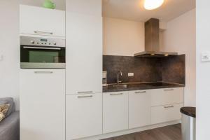 Een keuken of kitchenette bij Duinstraatje 1