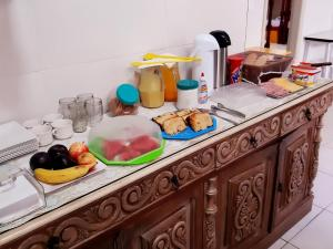 A kitchen or kitchenette at Hostel Vila Praiana
