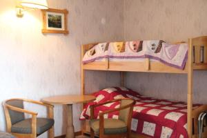 A bunk bed or bunk beds in a room at Forest Haven Inn