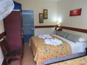 Una cama o camas en una habitación de Posada Del Arbol