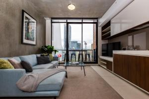 A seating area at CHIC South Yarra Apartments close to Chapel St