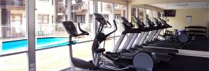 The fitness center and/or fitness facilities at Ramada Hotel & Suites by Wyndham Cabramatta