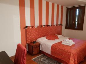 Letto o letti in una camera di Locanda Da Vittorio