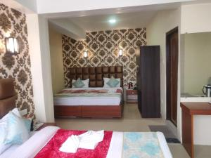 A bed or beds in a room at Mystic Valley Gangtok