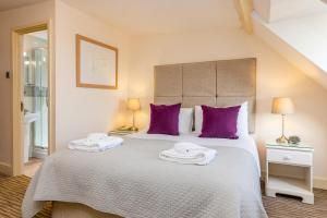 A bed or beds in a room at Swan Revived Hotel