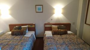 A bed or beds in a room at Kuretake-Inn Iwata