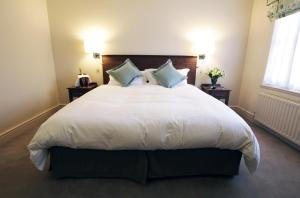 A bed or beds in a room at The Woburn Hotel