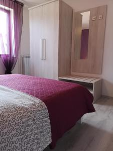 A bed or beds in a room at Apartments Peloža