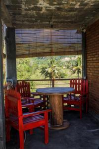 Restaurant ou autre lieu de restauration dans l'établissement La Calypso Guesthouse