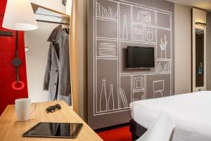 A television and/or entertainment center at ibis London East Barking