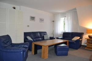 A seating area at Apartmány Holiday Pec