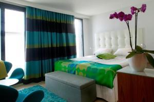 Säng eller sängar i ett rum på Avalon Hotel