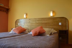 Un ou plusieurs lits dans un hébergement de l'établissement La Paumanelle