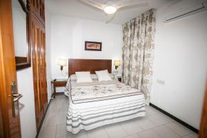 A bed or beds in a room at Hostal Venta Del Sol