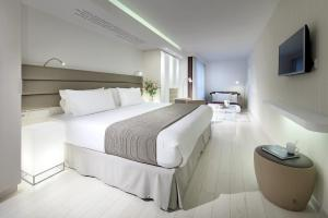 A bed or beds in a room at Eurostars Book Hotel
