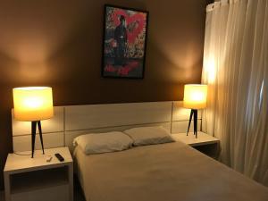 Cama ou camas em um quarto em Aldeia das Águas Barrakana flats