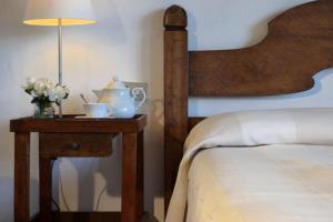 Letto o letti in una camera di Locanda di Praticino