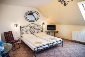 Ein Bett oder Betten in einem Zimmer der Unterkunft Penzion Eden
