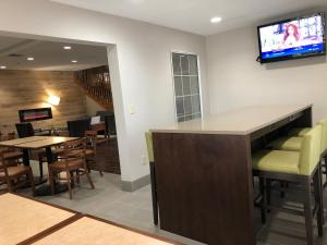A television and/or entertainment center at Country Inn & Suites by Radisson, Topeka West, KS