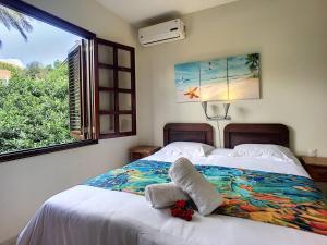 Cama ou camas em um quarto em Cool and Breezy 3 BR Villa in Blue Bay Beach