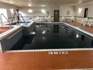 The swimming pool at or near Country Inn & Suites by Radisson, Topeka West, KS