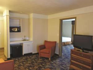 A television and/or entertainment center at La Quinta by Wyndham Seguin