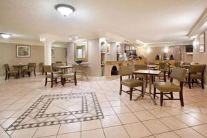 A restaurant or other place to eat at La Quinta Inn by Wyndham Denver Central