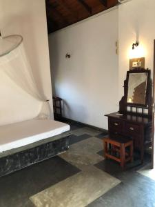 A bed or beds in a room at Villa Araliya