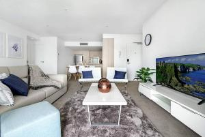 A seating area at Broadbeach 2 Bedroom FREE WIFI, Netflix & Parking