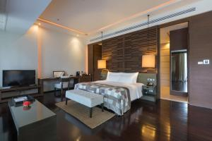 A bed or beds in a room at Cape Nidhra Hotel
