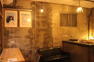 The lobby or reception area at Kamp Houkan-cho Backpacker's Inn & Lounge