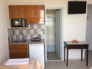 Η κουζίνα ή μικρή κουζίνα στο Villa Popi