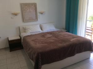 Ένα ή περισσότερα κρεβάτια σε δωμάτιο στο Villa Popi