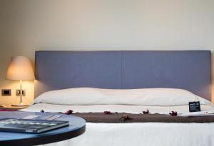 A bed or beds in a room at T Hotel