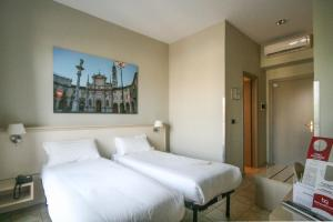A bed or beds in a room at Best Quality Hotel Dock Milano