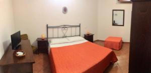 A bed or beds in a room at La Terrazza Di San Vito