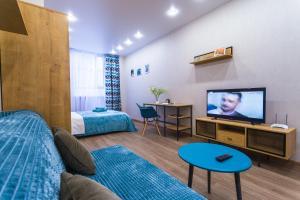 Телевизор и/или развлекательный центр в Graf Orlov. Comfort Apartments