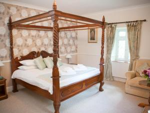 A bed or beds in a room at Llechwen Hall